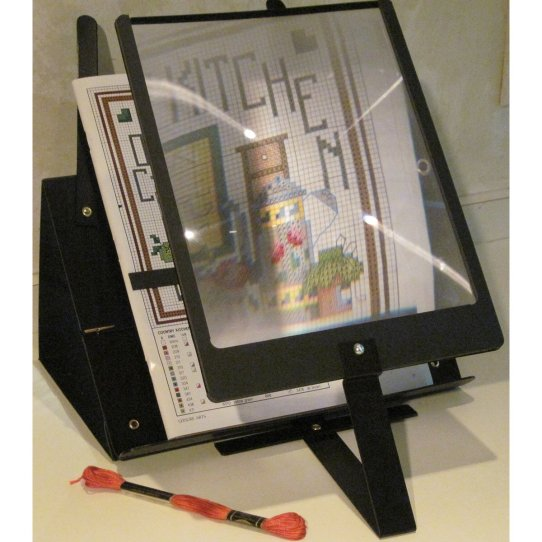 Book stand with magnifier
