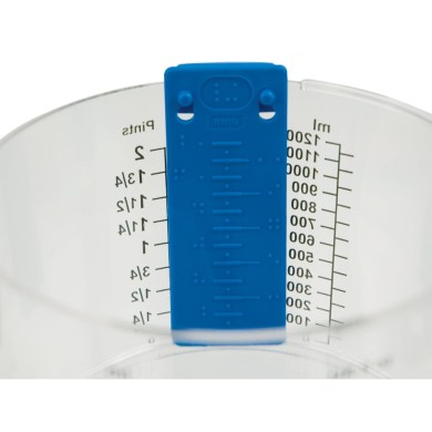 Tactile measuring cup