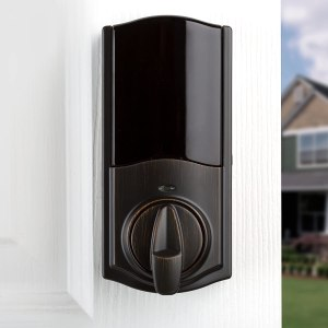 Image of what the Kwikset Smart Lock looks like installed on a house front door.