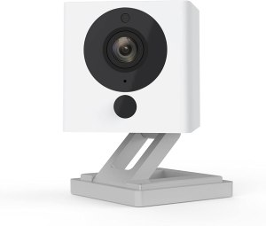 Image of a white, square, angle adjustable interior security camera.